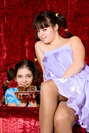 Two Lovely teen girls with cake photo