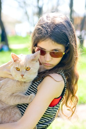 Teen girl with cat outdoor photo