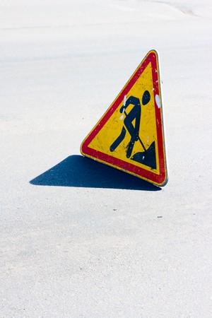 inhibitory: Road sign of repair work on asphalt