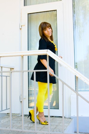 nominally: Portrait happy girl on balcony