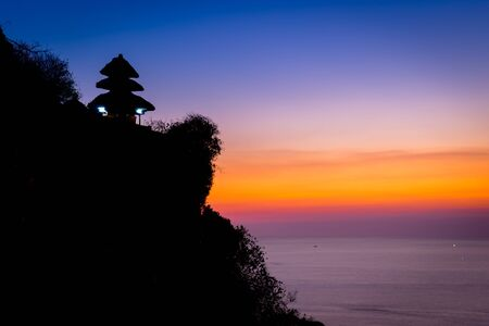 Uluwatu temple silhouette, Bali Indonesia photo