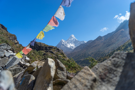 stack stone: Ama Dablam with stack stone and prayer flag, Everest region, Nepal