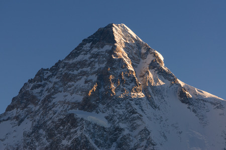 Sunlight on top of K2 mountain peak in a morning, K2 trek, Pakistan, Asia