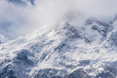 Nanga Parbat mountain peak in cloudy day, Fairy Meadow, Pakistan, Asia