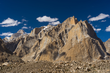 Great Trango tower and Cathedral tower cliff at Khobutse camp, K2 trek, Pakistan, Asia Stock Photo