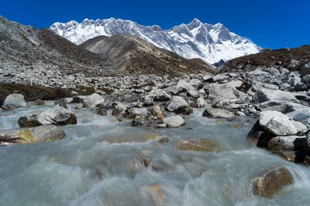 Lhotse mountain peak behide samll canal, Everest region, Nepal, Asia