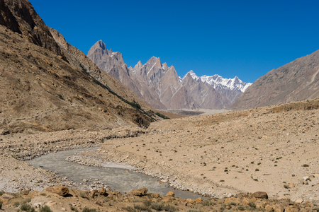 spire: Landscape of Trango tower family, Lobsang spire and river, K2 trek, Skardu,  Pakistan, Asia