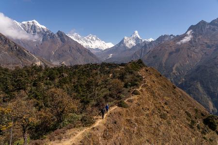 Trekkers walk on the ridge in Everest trekking route, Himalayas mountain, Nepal, Asia
