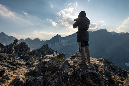 A man take picture of Himalaya mountains on top of Gokyo Ri in Everest base camp trek, Nepal, Asia