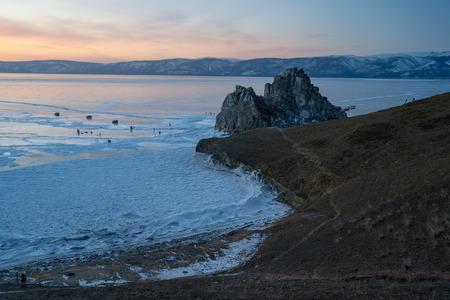Beautiful sunset at Shaman rock, sacred stone of Olkhon island, Baikal lake, Siberia, Russia, Asia