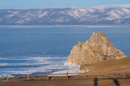 Shaman rock, holy stone of Olkhon island in Baikal frozen lake in winter season, Siberia, Russia, Asia