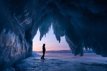 Ice cave in Baikal frozen lake in winter season, Siberia, Russai, Asia 版權商用圖片