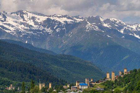 Traditional Svaneti watch tower in Mestia in summer season, Caucasus mountain range in Georgia, Europe