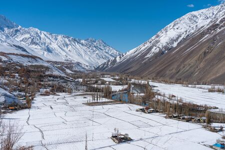 Beautiful winter season in Phander valley with fresh snow, Hindu Gush mountains range in Gilgit Baltistan, Pakistan, Asia