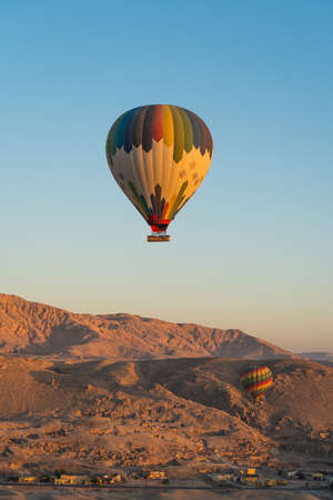 Hot air Balloons over Valley of the King in Luxor city in a morning sunrise, Upper Egypt, Africa Foto de archivo