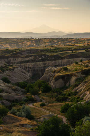 Landscape of Goreme ancient town in a morning sunrise. Cappadocia plateau in middle of Anatolia region in Turkey, Asia Stock fotó