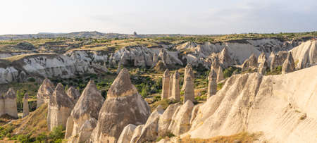 Beautiful morning at Love valley, Goreme town in Cappadocia, central Anatolia of Turkey, Asia. Panoramic banner portion Stock fotó