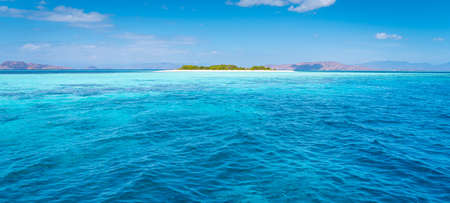 Crystal clear water around Flores island national park in summer season, Indonesia, Asia. Panoramic banner portion