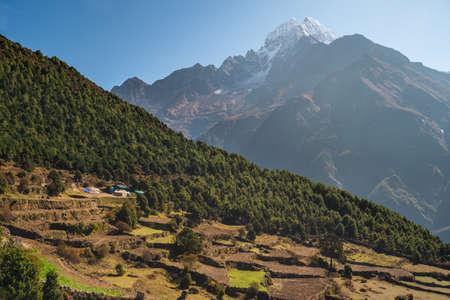 Beautiful mountains valley in Everest base camp trekking route with Thamserku mountain peak behind. Himalaya mountains range in Nepal, Asia
