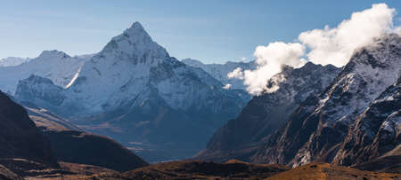 Ama Dablam mountain peak, most beautiful peak in Everest region view from Chola pass, Hima;ayas mountain, Nepal, Asia. Panoramic banner portion