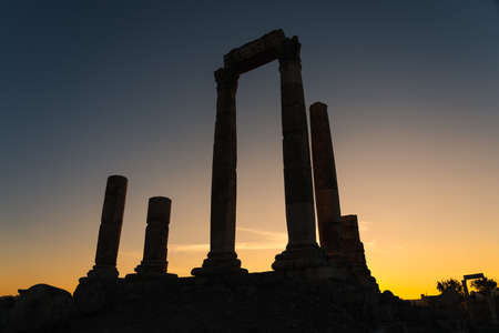 Amman Citadel, ruin and ancient Roman architecture and city on top of mountain in Amman at evening sunset, Jordan, Asia