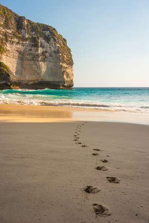 Footprints on Kelingking beach in evening sunset, Nusa Penida island in Indonesia, Asia