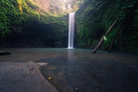 Tibumana Waterfall, beautiful waterfall in tropical jungle in central of Bali island, Indonesia, Asia