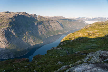 Beautiful landscape of mountains and lake between the way to Trolltunga cliff in Odda, western of Norway in summer season, Norway, Scandinavia, Europe