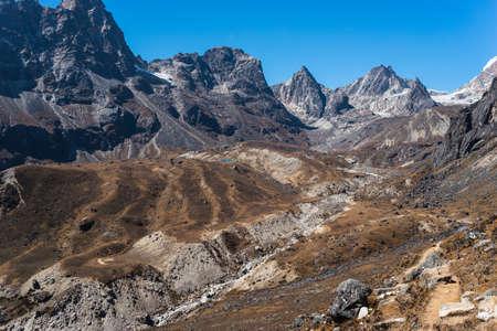 Trekking trail to Dzongla village, last village before cross Chola pass in Everest base camp trekking route, Himalaya mountians range in Nepal, Asia