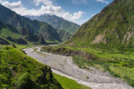 Beautiful landscape of Caucasus mountains and Terek river in summer season, Kazbegi town in Georgia country, Europe