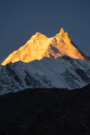 Manaslu peak at sunrise, eighth highest peak in the world in Himalayas range, Nepal, Asia 版權商用圖片