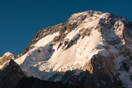 Broadpeak mountain peak in evening sunset in Karakoram mountains range