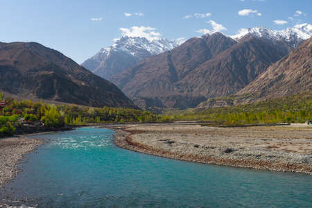 Beautiful blue river of Ghizer view from Ghizer valley surrounded by Hindu Gush mountains range, North Pakistan, Asia