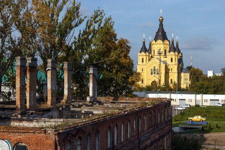 Autumn Nizhny Novgorod. The tumbledown house and Alexander Nevsky Cathedral on the Strelka
