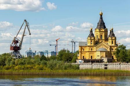 Alexander Nevsky Cathedral near the Nizhny Novgorod cargo river port on the Strelka. View from the Oka River