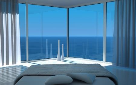 Moderne wei�e Schlafzimmer mit erstaunlichen Meerblickansicht Lizenzfreie Bilder