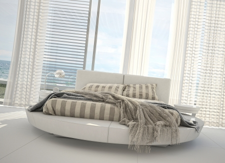 sea bed: modern white interior with bed and seascape view Stock Photo