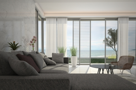 living room interior: modern living room with floor to ceiling windows Stock Photo