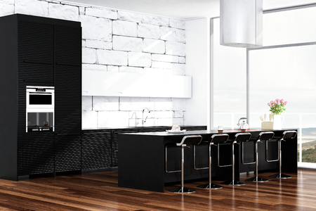 Contemporary black design kitchen in front of white stone wall photo