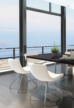 Modern dining table against floor to ceiling window with landscape view photo