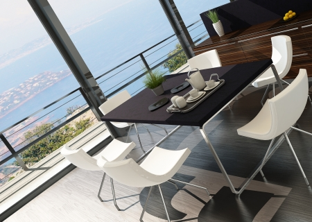 Stylish kitchen interior with dining table and seascape view photo