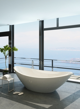 Expensive luxury bathtub against panoramic window with seascape view photo