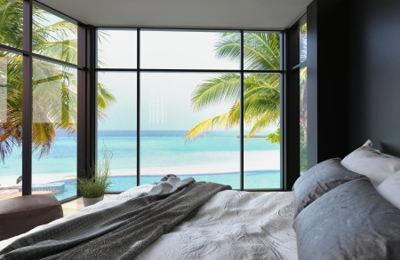 view of a comfortable bedroom: Tropical bedroom interior with double bed and seascape view Stock Photo