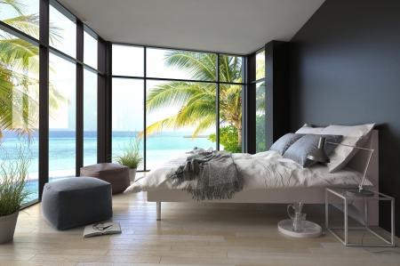 interni casa: Interno tropicale camera da letto con letto matrimoniale e vista marina Archivio Fotografico