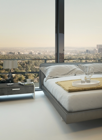 Modern design bed against window with landscape view photo