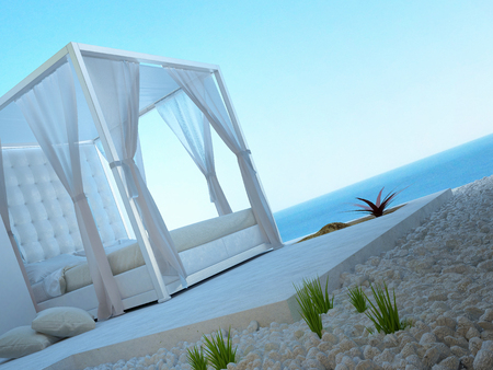 four poster bed: Sunny patio with seascape view and outside bed Stock Photo