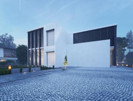夜明けに近代的なハウス外観
