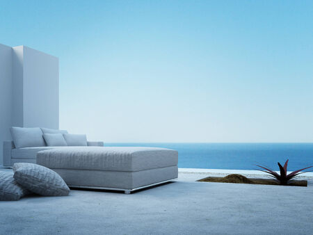Modern patio with white couch and seascape view