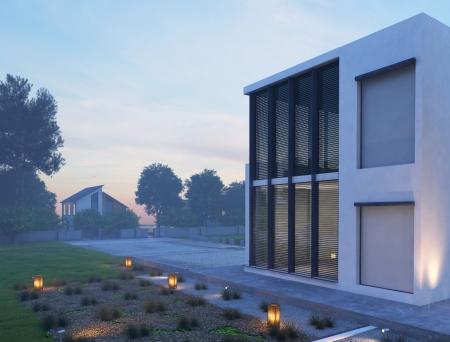 iluminacion: Exterior de la casa moderna en el crepúsculo