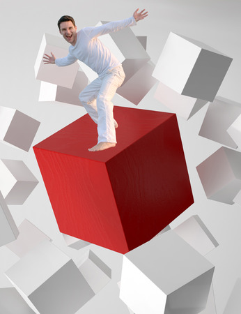 sh: Concept picture of a man riding a flying red cube Stock Photo